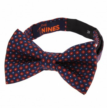 Navy blue bow tie with red dots